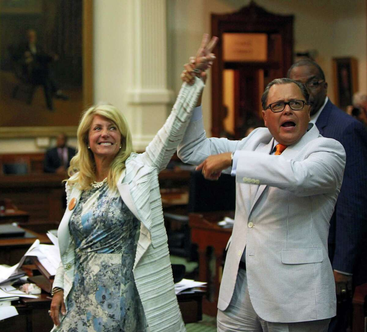 Senate Democrats Wendy Davis and Jose Rodriguez celebrate last week at the Capitol after the filibuster led by Davis defeated the GOP's anti-abortion bill.