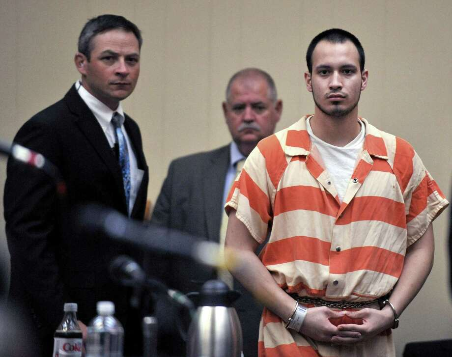 Pvt. Isaac Aguigui walks into the courtroom during a preliminary hearing at Long County Superior Court in Ludowici, Ga., in August. Photo: Stephen Morton / Associated Press