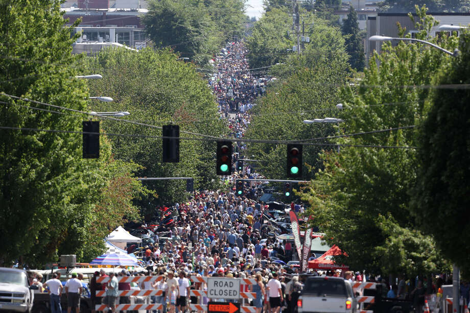 Thousands of people pack Greenwood Avenue North during the Greenwood Car Show on Saturday, June 29, 2013 in Seattle. The annual show is the largest single-day car show in the state. Photo: JOSHUA TRUJILLO, SEATTLEPI.COM