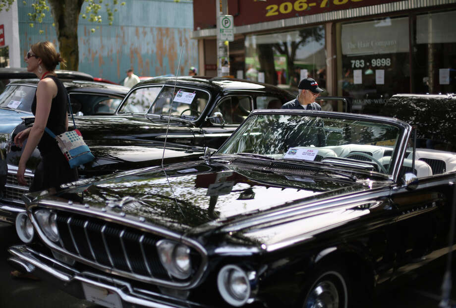 Cars are parked on Greenwood Avenue North during the Greenwood Car Show on Saturday, June 29, 2013 in Seattle. The annual show is the largest single-day car show in the state. Photo: JOSHUA TRUJILLO, SEATTLEPI.COM