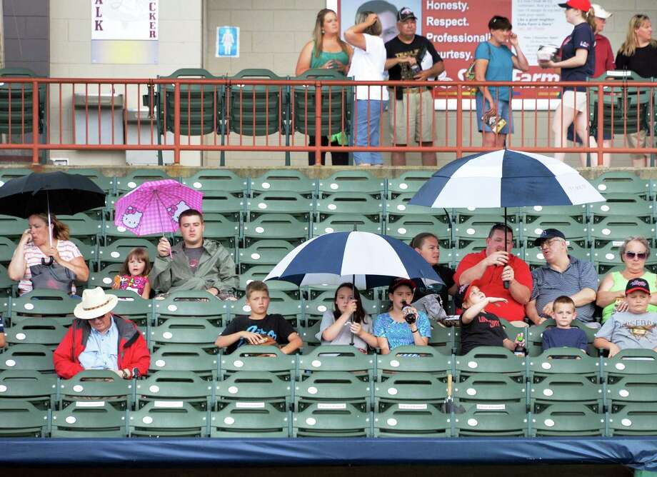 Tri-City ValleyCats fans brave a summer shower before the first game of a double header against the Connecticut Tigers at Joe Bruno Stadium in Troy, NY, Saturday June 29, 2013.  (John Carl D'Annibale / Times Union) Photo: John Carl D'Annibale / 00022938A