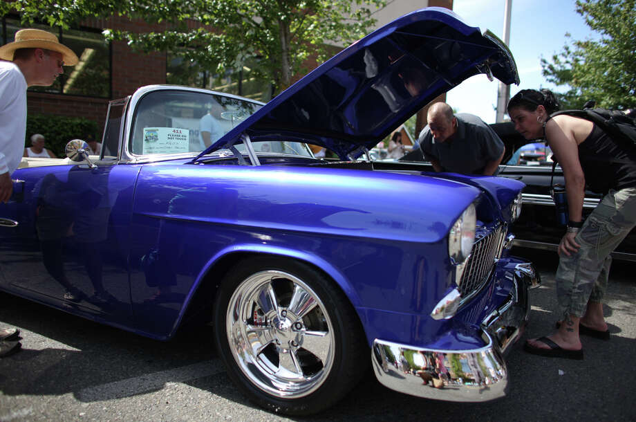 A 1955 Chevy Bel Aire is looked over during the Greenwood Car Show on Saturday, June 29, 2013 in Seattle. The annual show is the largest single-day car show in the state. Photo: JOSHUA TRUJILLO, SEATTLEPI.COM