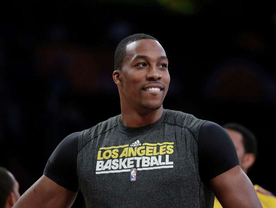 Free-agent center Dwight Howard wants his next team to contend for the NBA title. Photo: Jae C. Hong, STF / AP