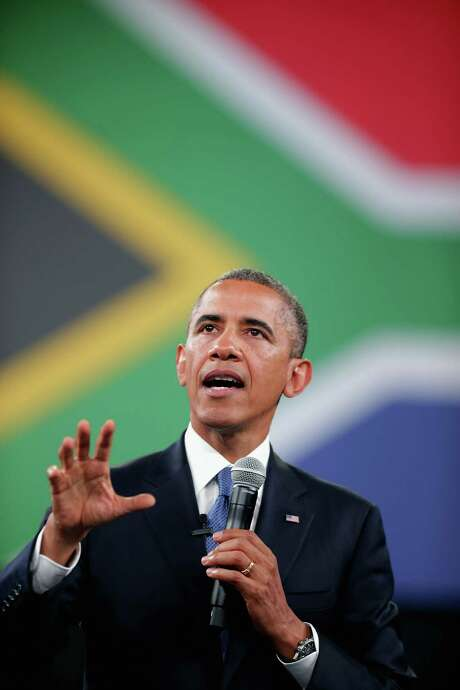"""JOHANNESBURG, SOUTH AFRICA - JUNE 29:  U.S. President Barack Obama answers questions from the audience and from people in Nigeria, Uganda and Kenya via live video link during a """"town hall"""" meeting with the young African leaders at the University of Johannesburg in Soweto June 29, 2013 in Johannesburg, South Africa. South Africa is the second leg of Obama's three-country tour of the African continent, which includes Senegal and Tanzania.  (Photo by Chip Somodevilla/Getty Images) *** BESTPIX *** Photo: Getty Images / 2013 Getty Images"""