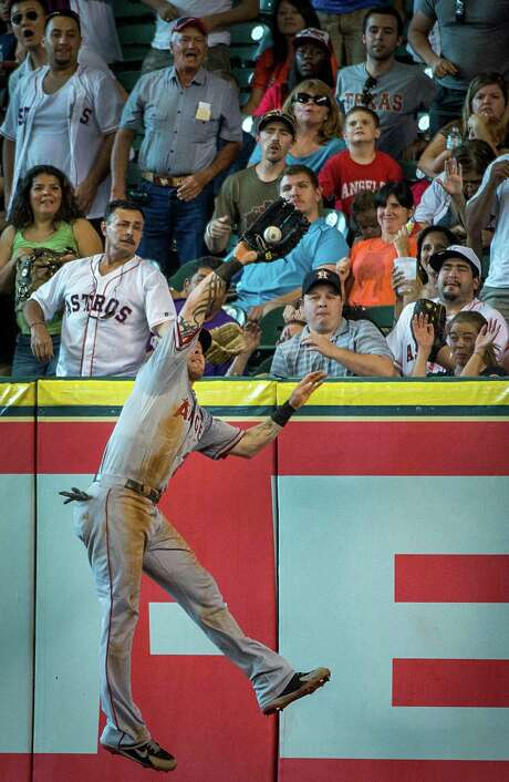 Angels right fielder Josh Hamilton takes a home run away from J.D. Martinez in the fifth inning Saturday. Photo: Smiley N. Pool / © 2013  Smiley N. Pool