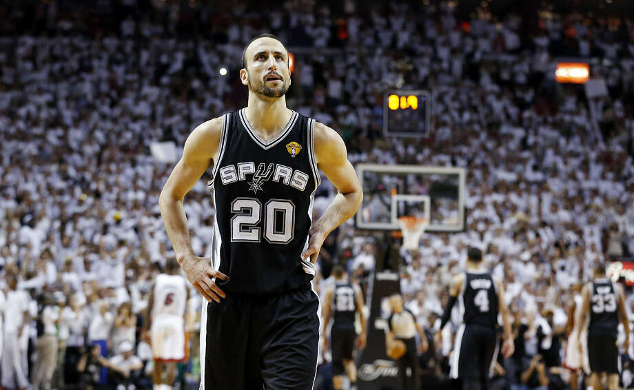 Manu Ginobili will have to take a steep pay cut from the team-high $14.1 million he earned last season in order to return to the Spurs. Photo: Edward A. Ornelas / San Antonio Express-News