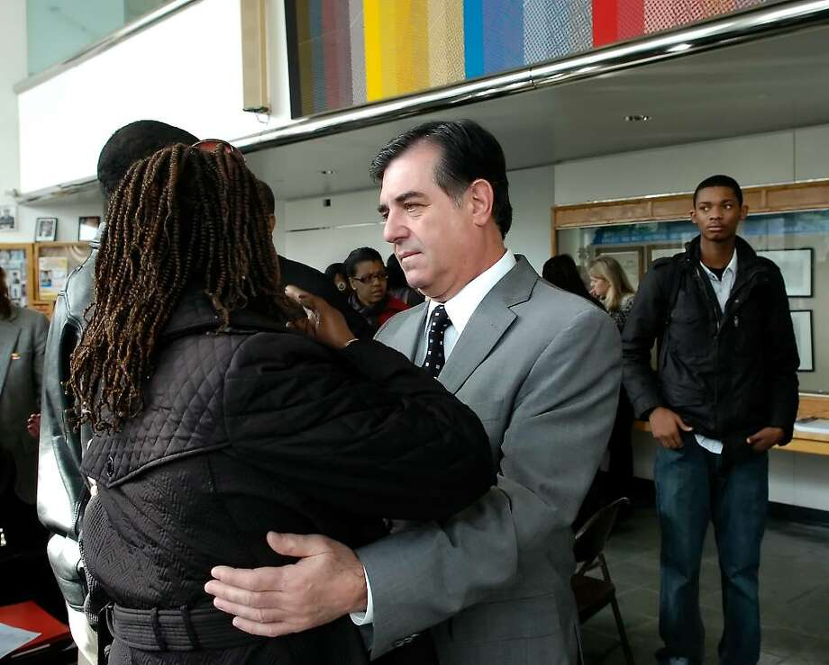 Friday Jan. 15th, 2010, Maud Guillaume a native of Haiti and a Stamford resident, left,  is comforted by Mayor Mike Pavia, right, during a community gathering at the Stamford Government Center to organize a relief effort for the victims of the earthquake which struck Haiti at 5pm on Jan. 12th 2010. Photo: Bob Luckey / Stamford Advocate