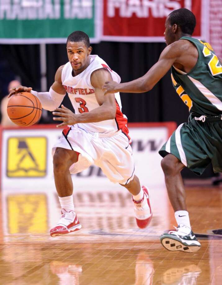 Fairfield's Derek Needham drives down the court during Saturday's game against Siena at the Arena at Harbor Yard. Photo: Autumn Driscoll / Connecticut Post
