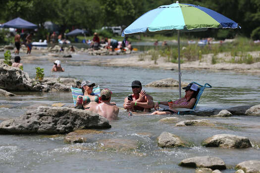 Recreationalists chill down in the waters of the Guadalupe River near New Braunfels  on June 29, 2013. Photo: TOM REEL
