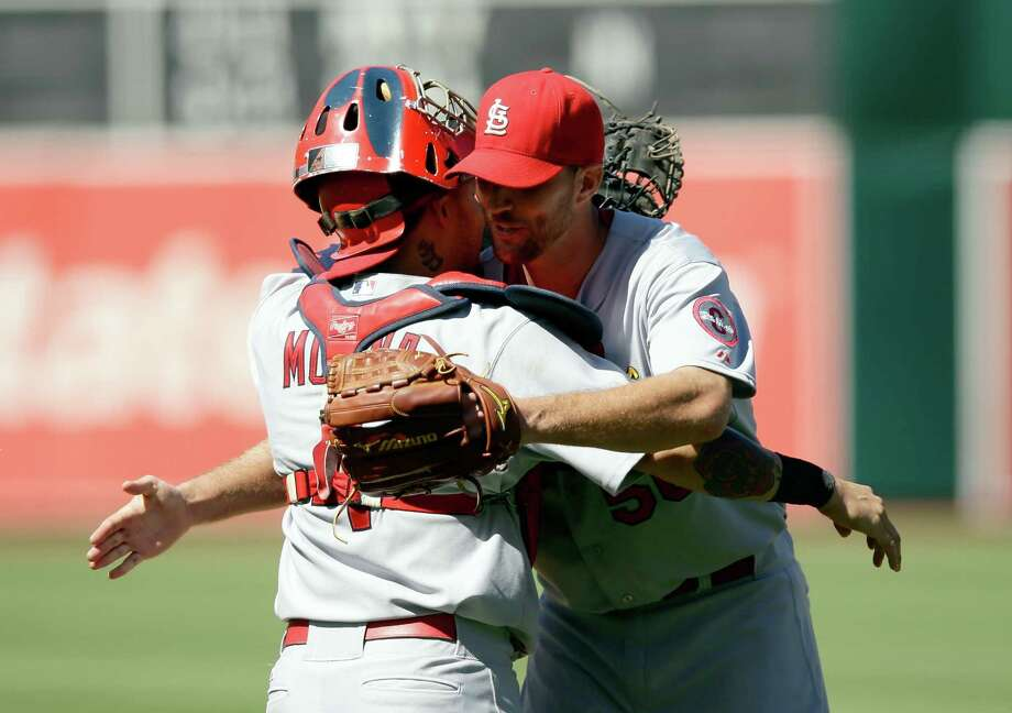 Cards pitcher Adam Wainwright is congratulated by catcher Yadier Molina after his complete game. Photo: Ezra Shaw / Getty Images