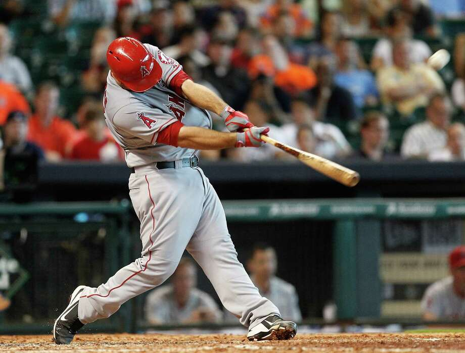 Chris Iannetta of the Angels blasts a two-run homer to left field in the eighth inning in Houston. Photo: Bob Levey / Getty Images