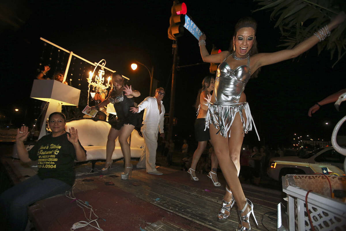 Dancers on the Ghalia Boutique float contend with a sudden stop during the parade.