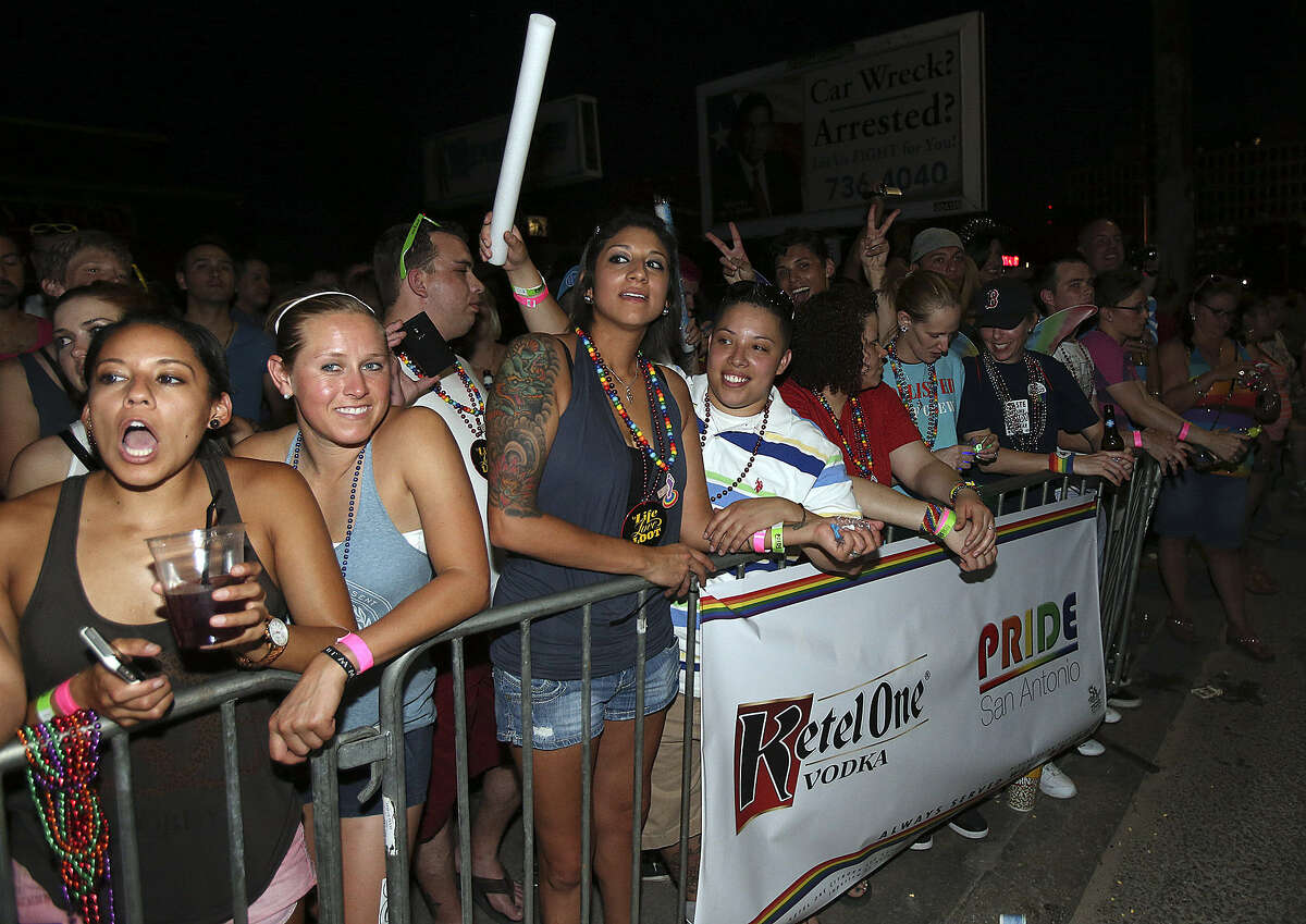 Spectators show their support during the Pride Bigger than Texas parade. Thousands of people attended the events.