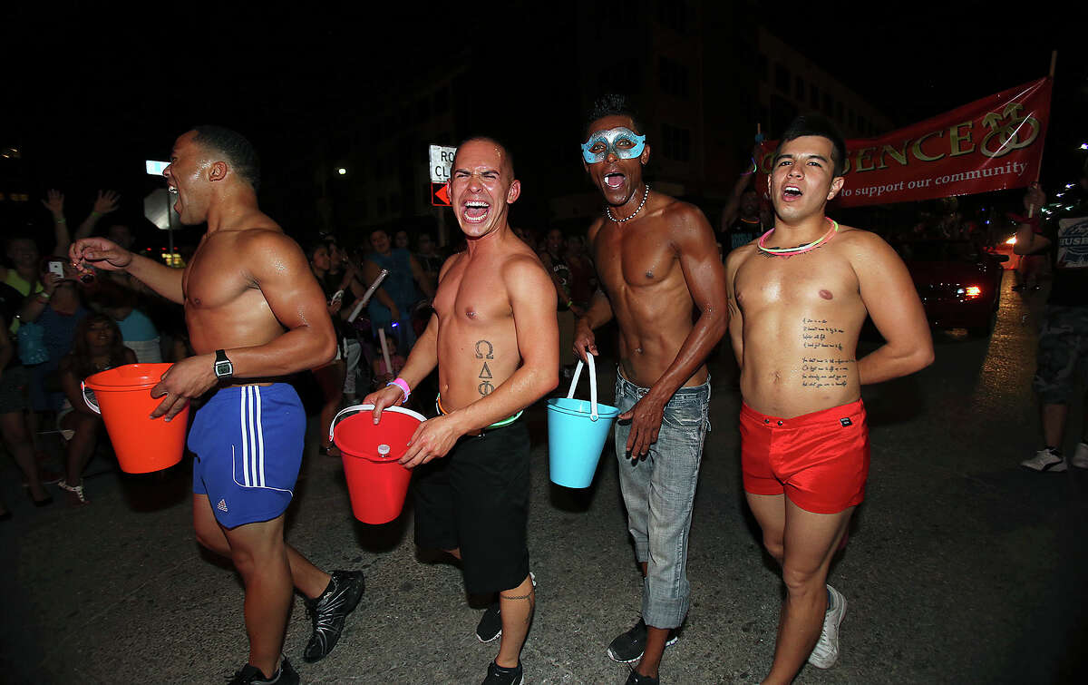 Members from Essence enjoy cheers as the Gay Pride march takes place in the evening after the Pride San Antonio Festival at Crockett Park on June 29, 2013.