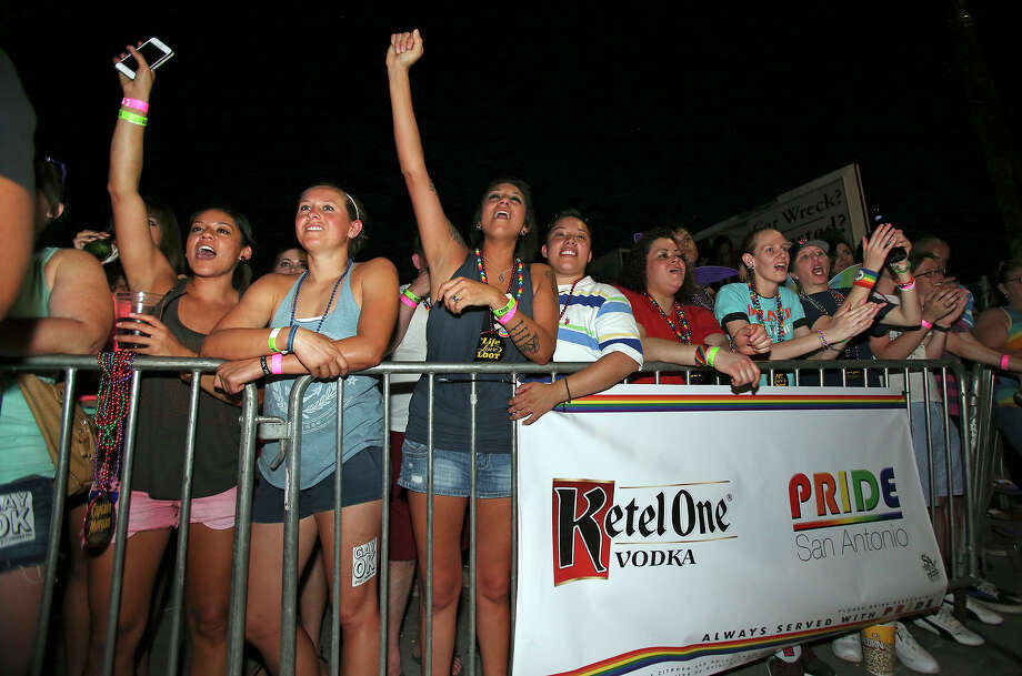 Spectators show supports as the  Gay Pride march takes place in the evening after the Pride San Antonio Festival at Crockett Park  on June 29, 2013. Photo: For The San Antonio Express-News