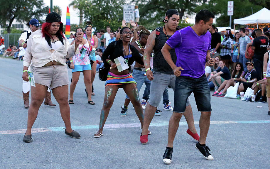 A spontaneous street dance starts  in the evening after the Pride San Antonio Festival at Crockett Park  on June 29, 2013. Photo: TOM REEL