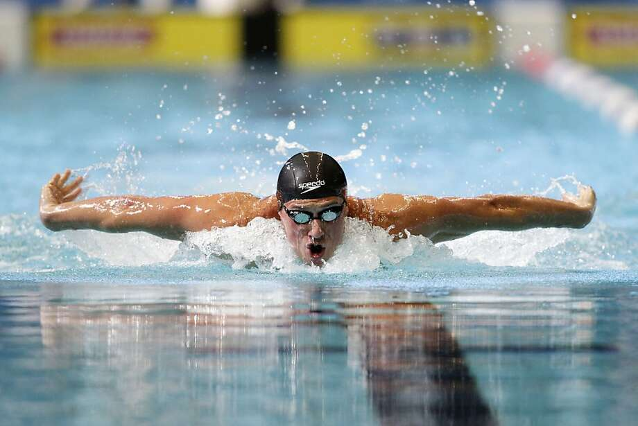 Ryan Lochte swims the butterfly stroke in the men's 200-meter individual medley during the U.S. National Championships swimming meet in Indianapolis, Saturday, June 29, 2013. Lochte won with a time of 1:55.44. (AP Photo/AJ Mast) Photo: AJ Mast, Associated Press