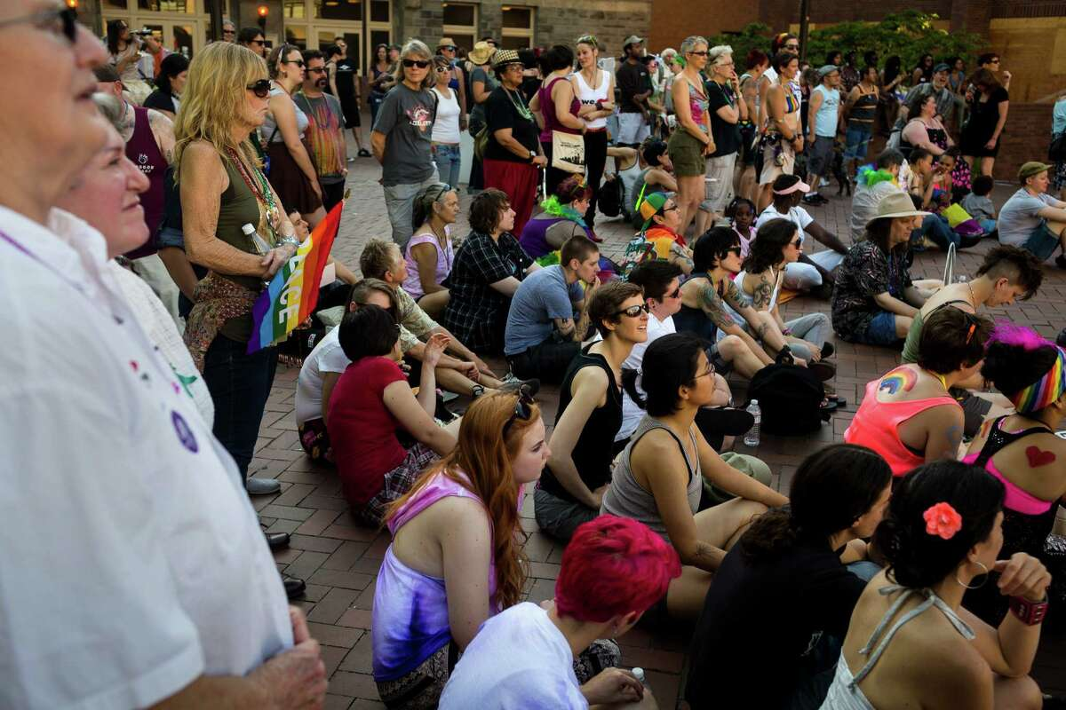 Groups clustered on the bricks of Seattle Central Community College to listen to a host of speakers and performers before the Seattle Dyke March Saturday, June 29, 2013, in Seattle. The march, held every year, intends to increase lesbian visibility and activism without focusing on labels, such as bisexual, intersex and transgendered women.