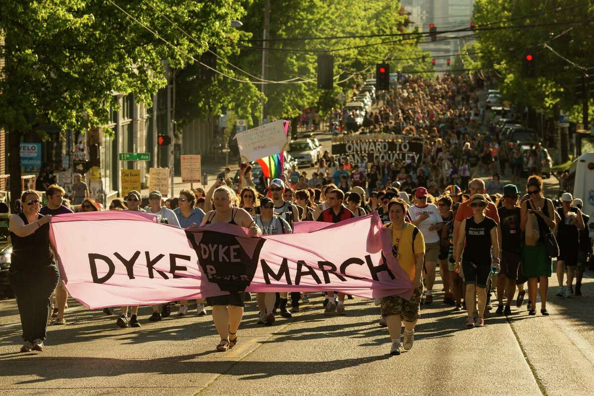Jubilant groups of individuals rallied together for a circular roundabout of Capitol Hill during the Seattle Dyke March Saturday, June 29, 2013, in Seattle. The march, held every year, intends to increase lesbian visibility and activism without focusing on labels, such as bisexual, intersex and transgendered women.