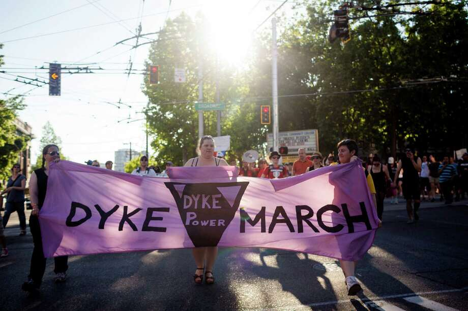 Individuals leave the Seattle Central Community College grounds, toting signs at the beginning of the Seattle Dyke March Saturday, June 29, 2013, in Seattle. The march, held every year, intends to increase lesbian visibility and activism without focusing on labels, such as bisexual, intersex and transgendered women. Photo: JORDAN STEAD, SEATTLEPI.COM / JORDAN STEAD