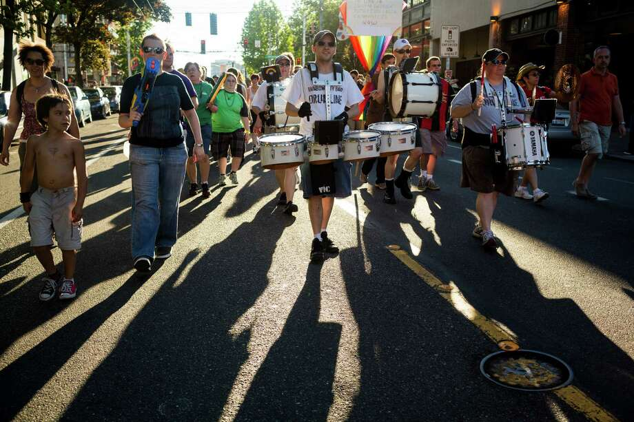 Drummers from the Rainbow City Band accompanied groups of attendees during the Seattle Dyke March Saturday, June 29, 2013, in Seattle. The march, held every year, intends to increase lesbian visibility and activism without focusing on labels, such as bisexual, intersex and transgendered women. Photo: JORDAN STEAD, SEATTLEPI.COM / JORDAN STEAD