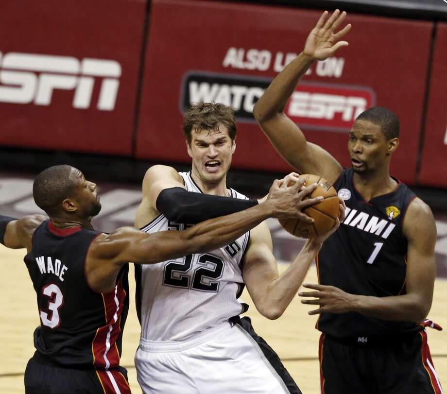 TIAGO SPLITTER  Position: Center/forward  2012-13: 10.3 ppg, 6.4 rpg, 0.8 bpg, 56.0 FG percentage  Status: Restricted  PHOTO: Splitter looks for room between the Miami Heat's Dwyane Wade and Chris Bosh during Game 4 of the 2013 NBA Finals on June 13, 2013, at the AT&T Center.  (Edward A. Ornelas / San Antonio Express-News)