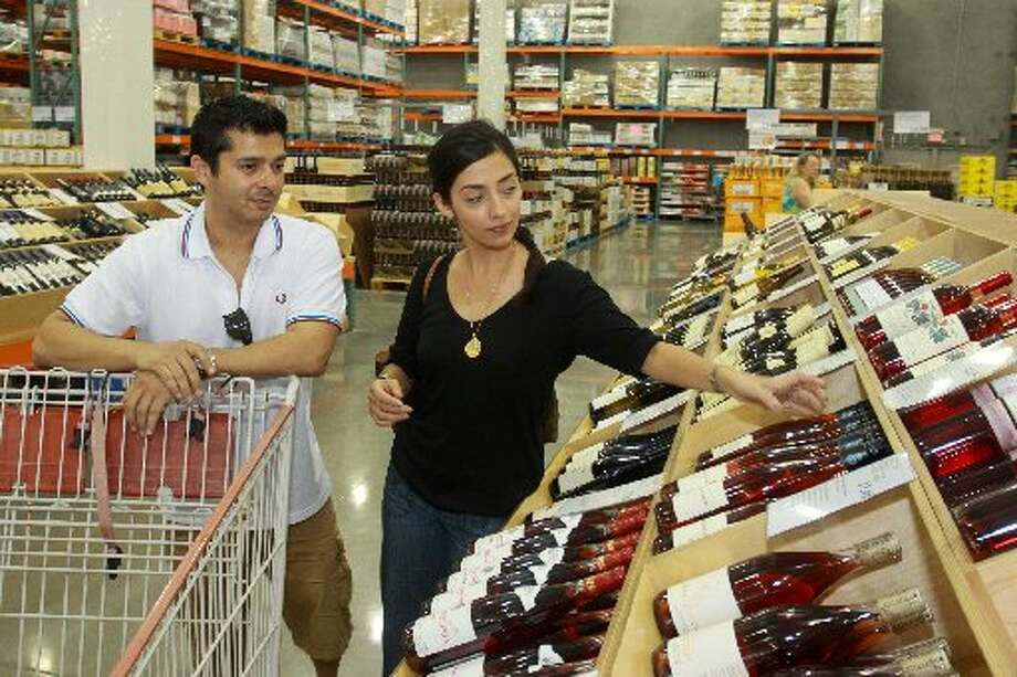 Hanif and Renata Dhanani shopping for wine at Costco.