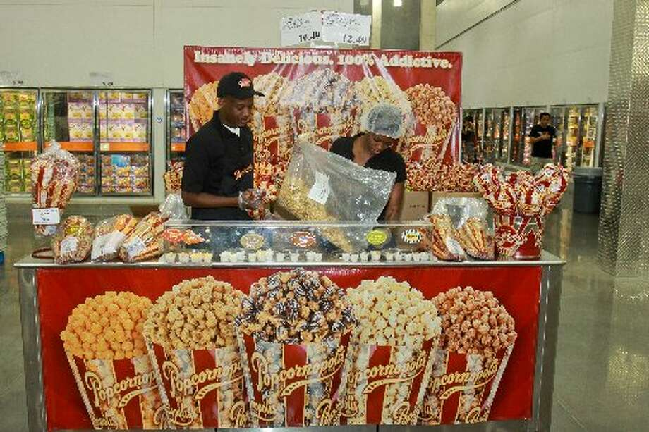 "Crystal Griggs and Jamaal Rutherford of Popcornopolis, one of Costco's ""road shows."""