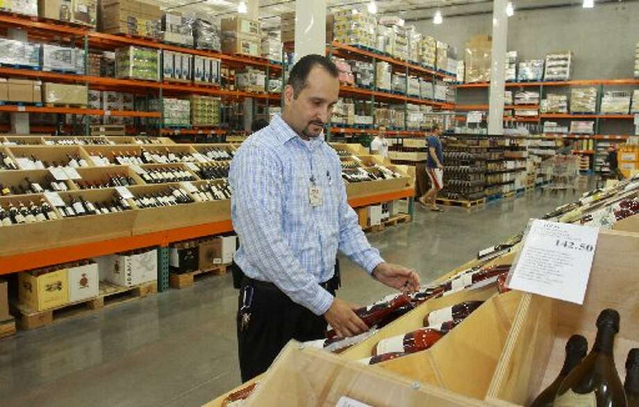 J.P. Polloreno straightening wine in the wine section of Costco.