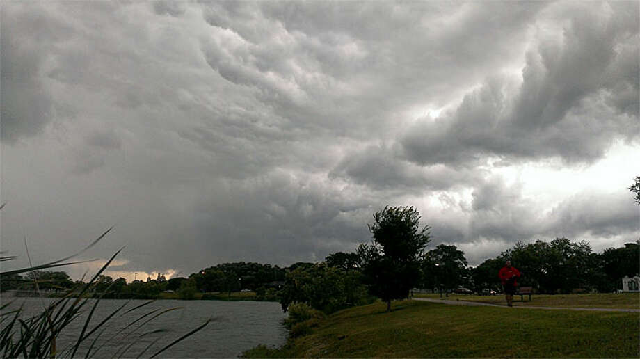 A cloudy sky at Woodlawn Lake early Sunday morning. Photo: John Tedesco/Express-News