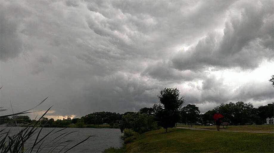 A cloudy sky at Woodlawn Lake early Sunday morning. Photo: John Tedesco/Express-News