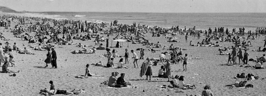 San Franciscans worshiping the sun at Ocean Beach. June 18, 1945.