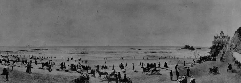 Ocean Beach with Cliff House in background, turn of the century.