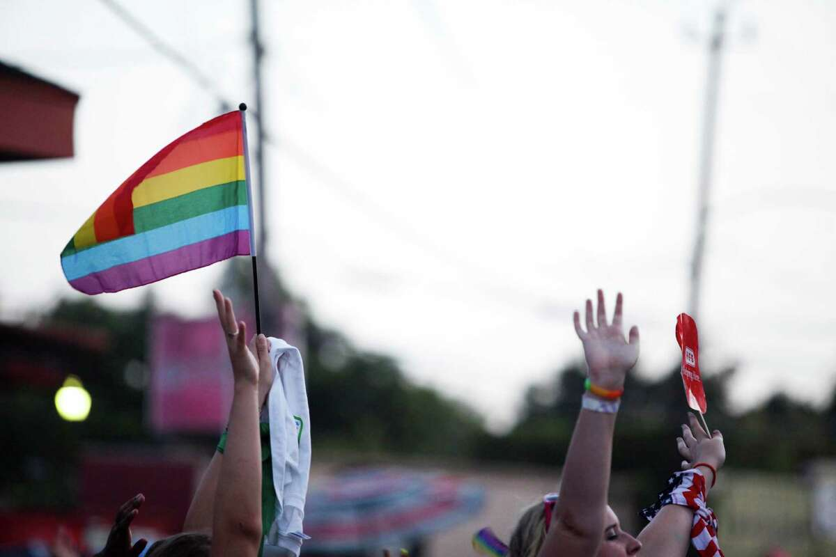 Attendees and participants celebrate during the 2013 Houston Pride Parade. A new study says doctors do a poor job of communicating with LGBT youth. (Eric Kayne/For the Chronicle)