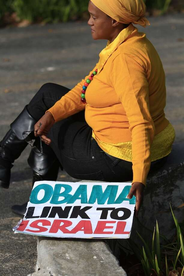 Protesters gather outside the University of Cape Town in advance of President Barack Obama's speech on June 30, 2013 in Cape Town, South Africa.