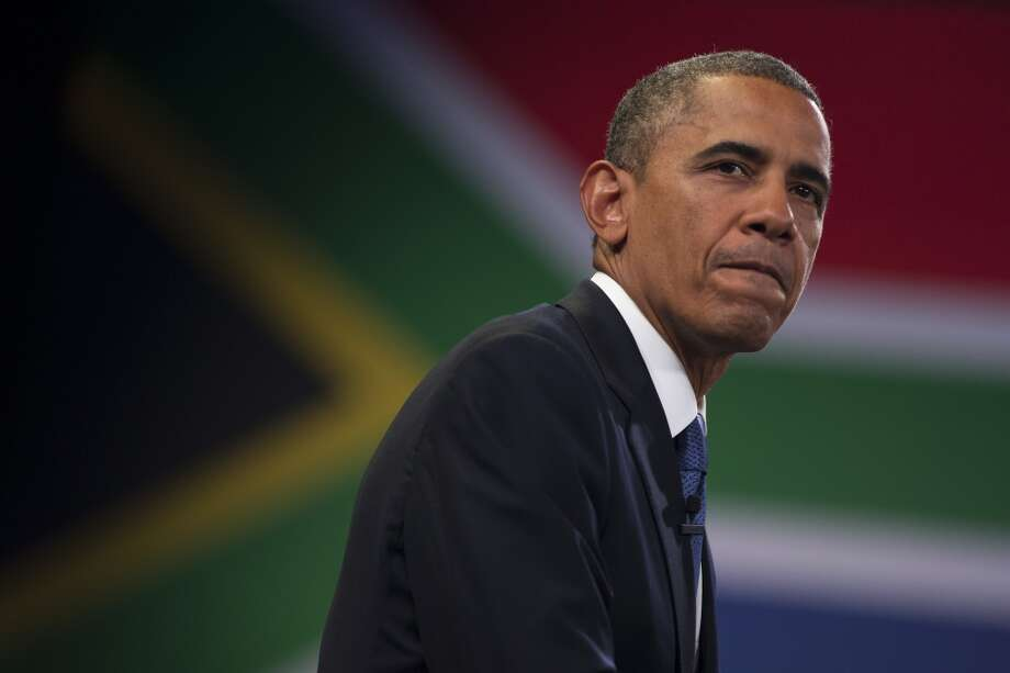 U.S. President Barack Obama pauses during a town hall meeting with young African leaders at the University of Johannesburg Soweto on Saturday, June 29, 2013.