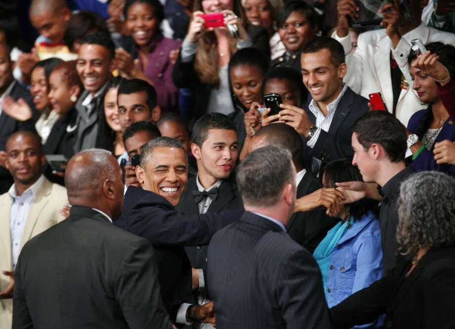U.S. President Barack Obama  greets the public as he arrives to deliver remarks and takes questions at a town hall meeting with young African leaders at  the University of Johannesburg Soweto  campus Saturday June 29, 2013.