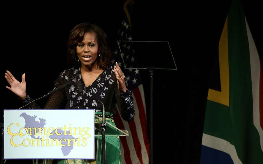 First lady Michelle Obama delivers a speech prior a discussion with students on June 29, 2013, at the Sci-Bono Discovery Center in Johannesburg. The first lady was joined by teenagers from accross South Africa as well as students joining virtually from cities around the US.