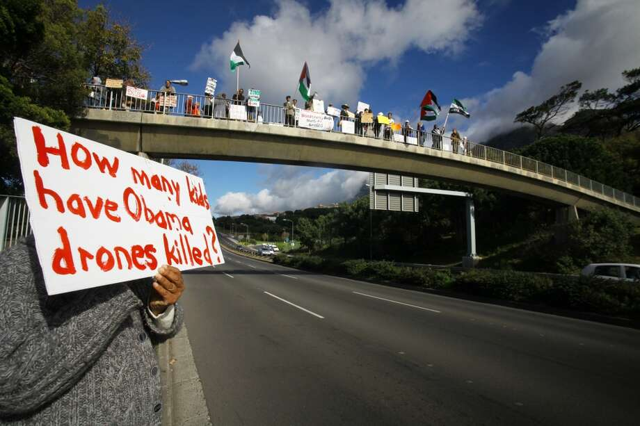 Protestors hold the Palestinian flags during a demonstration on an overpass bridge on the M3 against the visit of US President Barack Obama outside the University of Cape Town (UCT) in South Africa on June 30, 2013. Obama is due to speak at UCT this evening on the last day of his state visit to South Africa. AFP PHOTO/STRINGER-/AFP/Getty Images