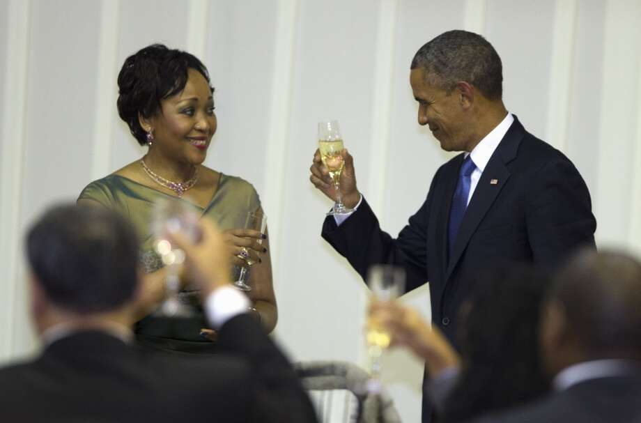 U.S. President Barack Obama, right, toasts with Thobeka Madiba-Zuma during an official dinner hosted by South African President Jacob Zuma at the Presidential Guest House on Saturday, June 29, 2013, in Pretoria, South Africa. The visit comes at a poignant time, with former South African president and anti-apartheid hero Nelson Mandela ailing in a Johannesburg hospital. (AP Photo/Evan Vucci)