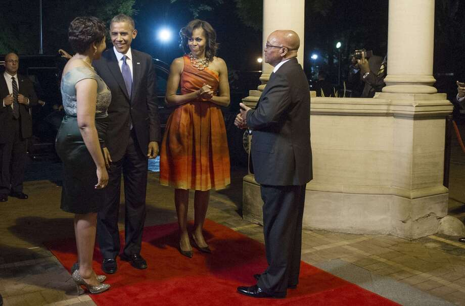 US President Barack Obama (2nd L) and First Lady Michelle Obama (2nd R) are greeted by South African President Jacob Zuma (R) and his wife Thobeka Zuma as they arrive for an official dinner in Pretoria, South Africa, June 28, 2013. AFP PHOTO / JIM  WATSONJIM WATSON/AFP/Getty Images