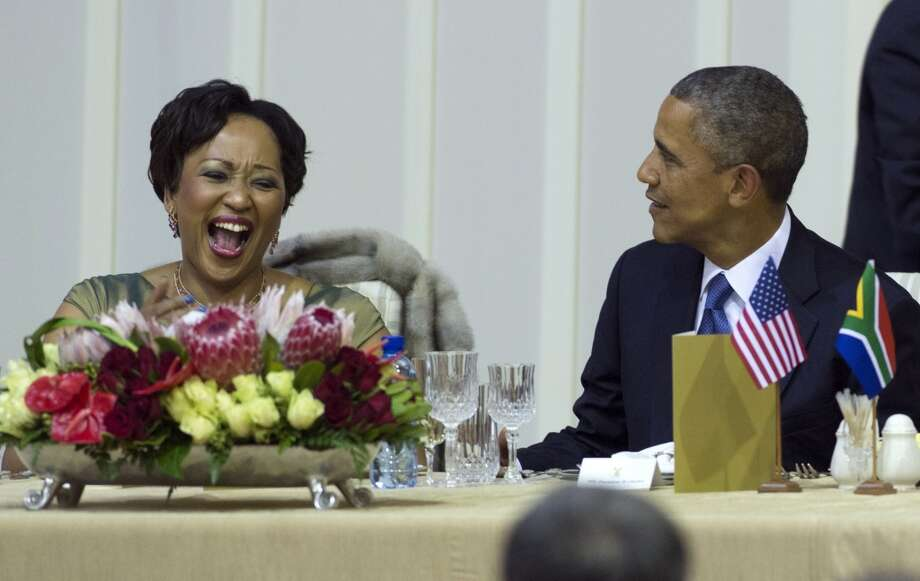 US President Barack Obama (R) shares a laugh with Thobeka Zuma, the wife of the South African president, during an official dinner at the Presidential Guest House in Pretoria, South Africa, on June 29, 2013. AFP PHOTO / Saul LOEBSAUL LOEB/AFP/Getty Images