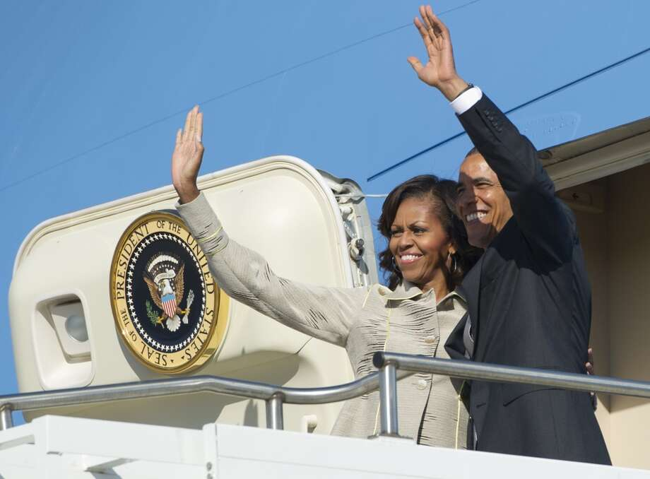 US President Barack Obama and First Lady Michelle Obama wave from Air Force One prior to departing from Waterkloof Air Base in Pretoria, South Africa, June 30, 2013, enroute to Cape Town. AFP PHOTO / Saul LOEBSAUL LOEB/AFP/Getty Images