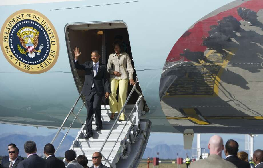US President Barack Obama and First Lady Michelle Obama disembark from Air Force One upon arrival at Cape Town International Airport in Cape Town, South Africa, on June 30, 2013. AFP PHOTO / Saul LOEBSAUL LOEB/AFP/Getty Images