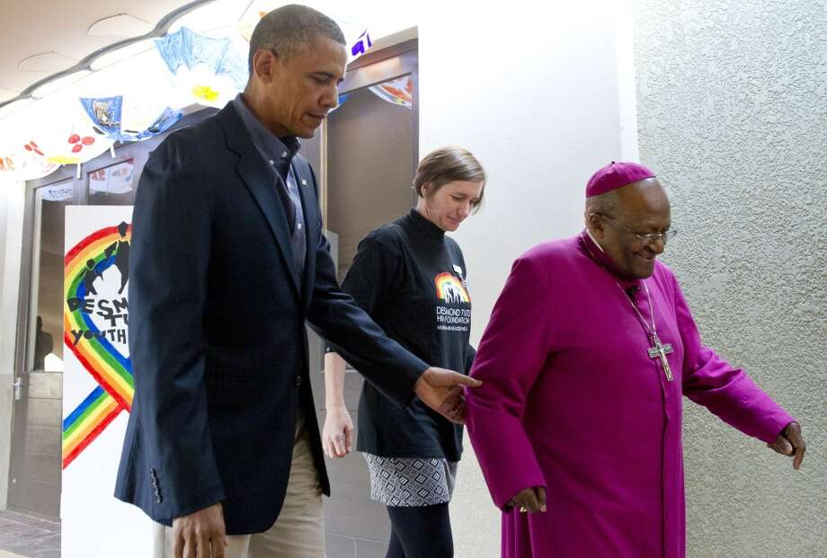 "US President Barack Obama (L) talks with Desmond Tutu (R) as he tours the Desmond Tutu HIV Foundation Youth Centre in Cape Town, South Africa, on June 30, 2013. Obama was ""deeply humbled"" by a visit to the cell where Nelson Mandela spent years as a prisoner, in a solemn homage Sunday to the critically ill hero he was unable to see in Pretoria. AFP PHOTO / Saul LOEBSAUL LOEB/AFP/Getty Images"