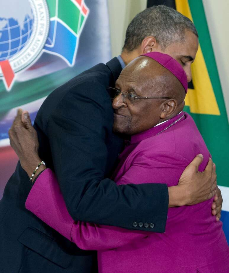 "US President Barack Obama (L) embraces Desmond Tutu following a tour of the Desmond Tutu HIV Foundation Youth Centre in Cape Town, South Africa, on June 30, 2013. Obama was ""deeply humbled"" by a visit to the cell where Nelson Mandela spent years as a prisoner, in a solemn homage Sunday to the critically ill hero he was unable to see in Pretoria.AFP PHOTO / Saul LOEBSAUL LOEB/AFP/Getty Images"