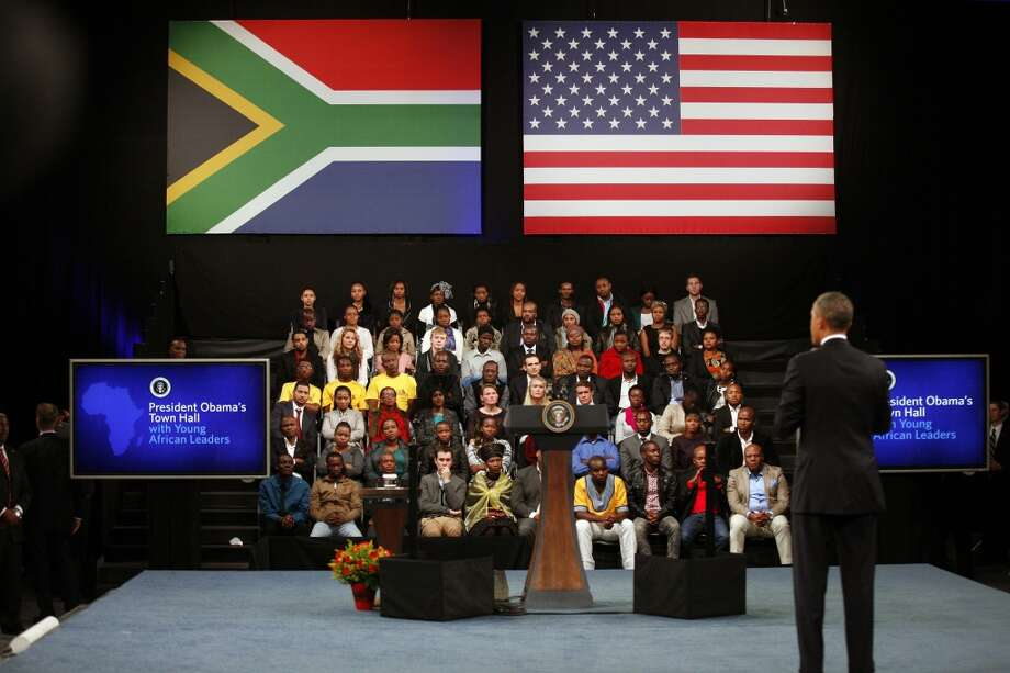 U.S. President Barack Obama  delivers remarks and takes questions at a town hall meeting with young African leaders at  the University of Johannesburg Soweto  campus Saturday June 29, 2013.(AP Photo/Jerome Delay)