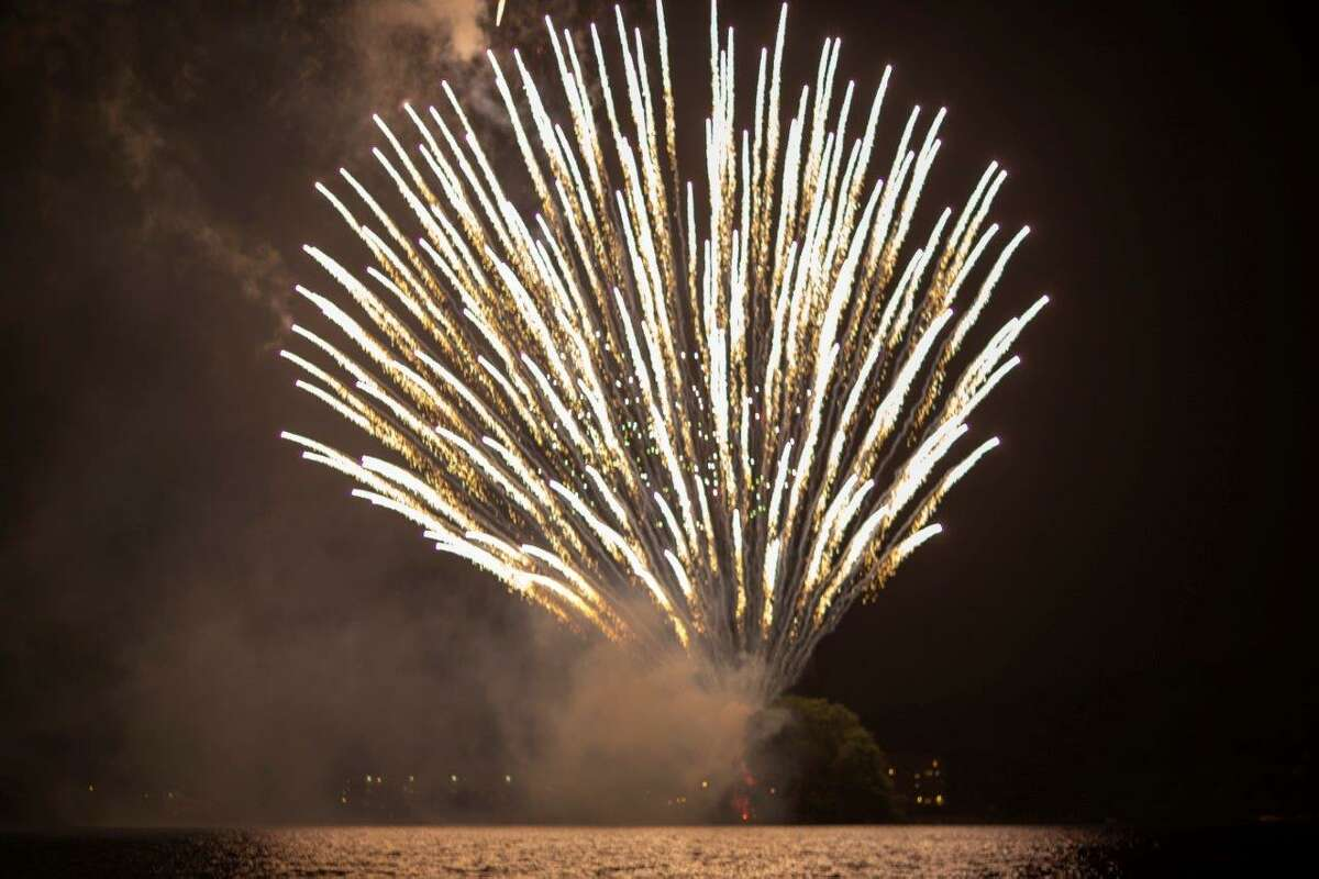 Fireworks are seen from a boat on Candlwood Lake in Danbury on June 29, 2013.