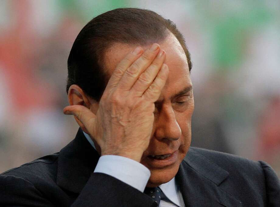 "In this file photo taken on Sept. 27, 2009, Italian premier Silvio Berlusconi gestures as he attends a meeting in Milan, Italy. A Milan court has convicted former Italian Premier Silvio Berlusconi of paying for sex with an under-age prostitute during infamous ""bunga bunga"" parties at his villa and then using his influence to try to cover it up. Berlusconi, 76, was sentenced to seven years in prison and barred from public office for life. The ban on holding office could mean the end of Berlusconi's two-decade political career. However, there are two more levels of appeal before the sentence would become final. Photo: AP"