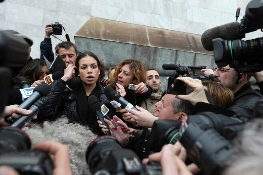 "In this file photo taken on April 4 2013, Karima el-Mahroug, the Moroccan woman at the center of ex-Premier Silvio Berlusconi's sex-for-hire trial, arrives at the court in Milan. A Milan court has convicted former Italian Premier Silvio Berlusconi of paying for sex with an under-age prostitute during infamous ""bunga bunga"" parties at his villa and then using his influence to try to cover it up. Berlusconi, 76, was sentenced to seven years in prison and barred from public office for life. The ban on holding office could mean the end of Berlusconi's two-decade political career. However, there are two more levels of appeal before the sentence would become final. Photo: AP"